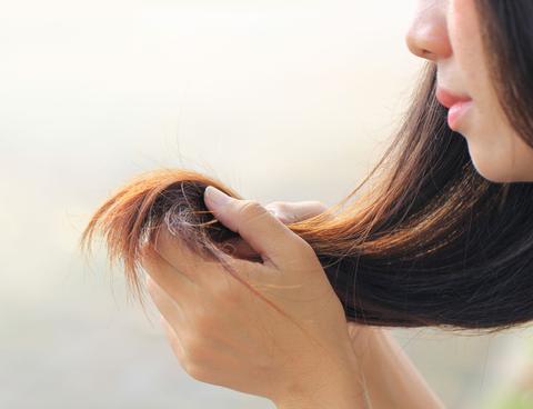 Frau mit beschädigtem Haar