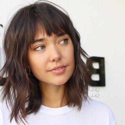 kurzes Haar mittellanges Haar Federschnitt